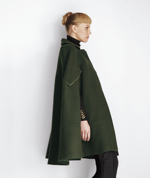 Model from side wearing military style cape