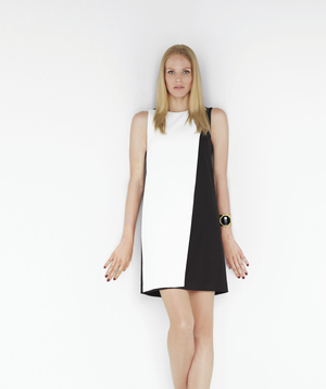 Model wearing black and white mod shift dress