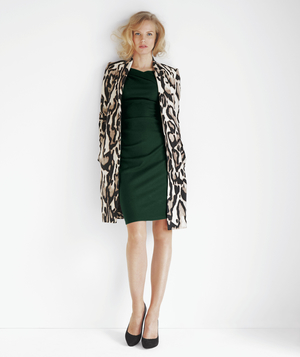 Model wearing ocelot print coat and black dress