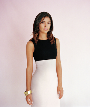 Model wearing Zara sheath dress and gold bangles