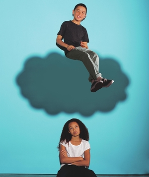 Boy on cloud over girl's head