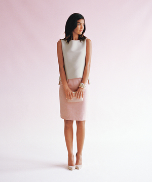 Model wearing silk top with pink skirt