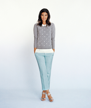 Model wearing gray sweater and pastel blue pants