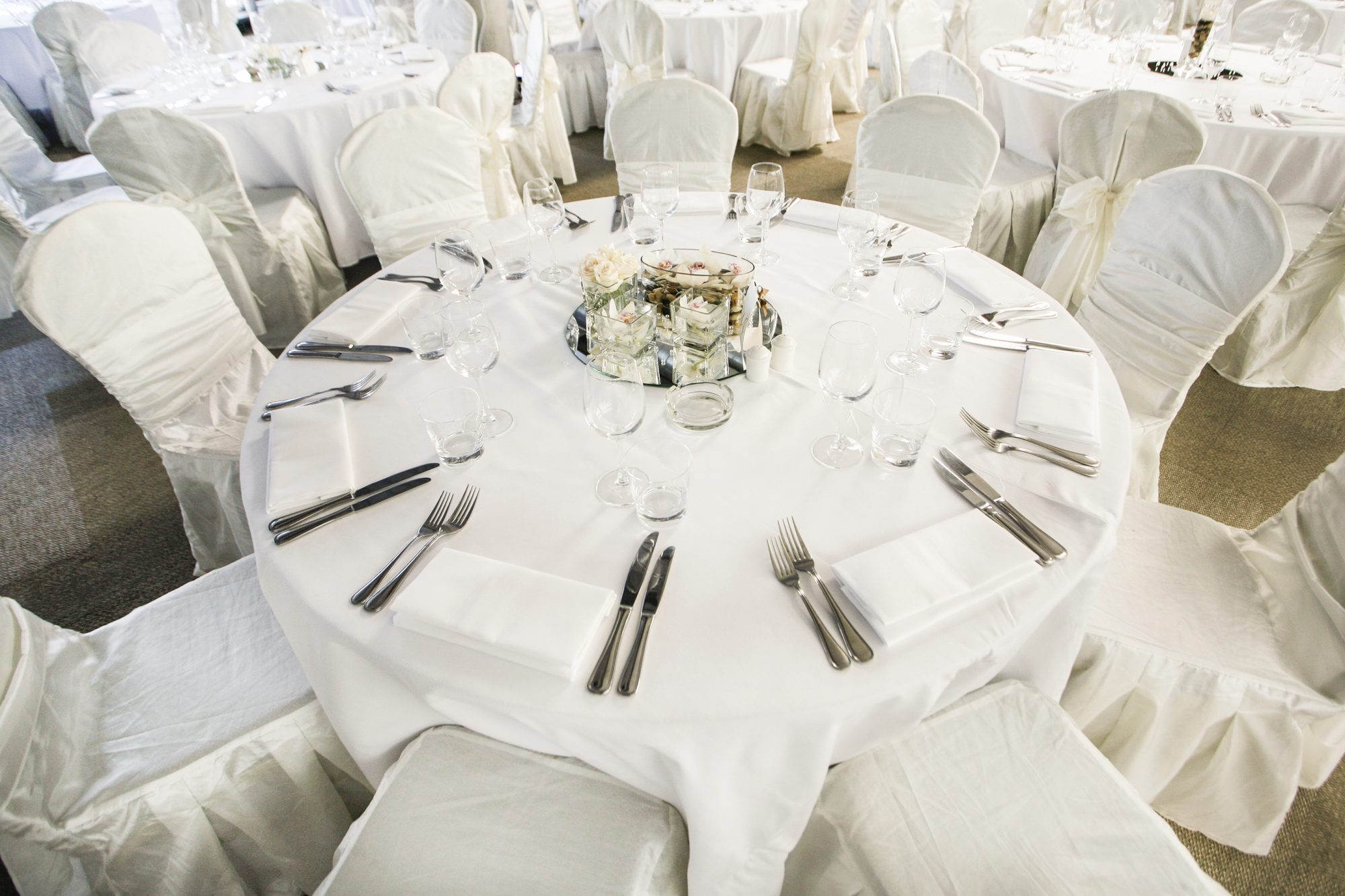 White wedding reception table and chairs