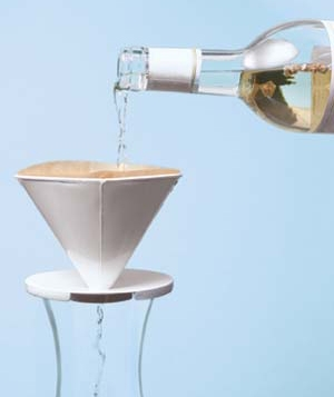 strainer with a bottle of wine