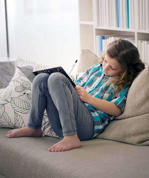 Girl doing homework on the couch