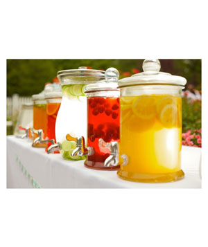 Drink dispensers at outdoor wedding party