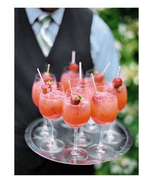 Glasses of strawberry sangria on tray