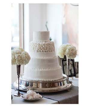 5-tier white wedding cake with rosette details