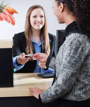 Bank teller in transaction with customer