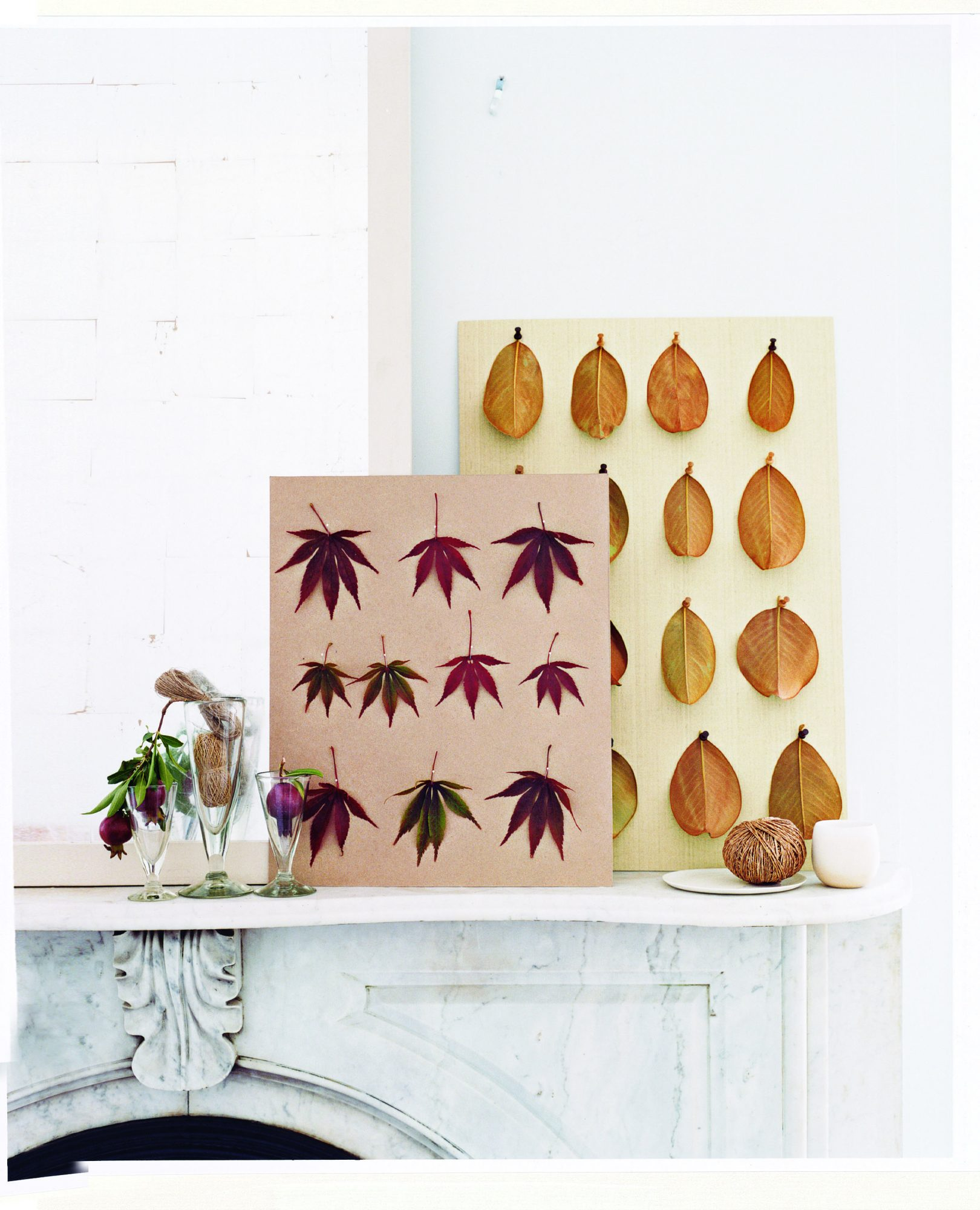 Colorful leaves pinned to a board on a mantle