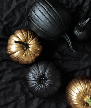 Black and gold spray-painted pumpkins