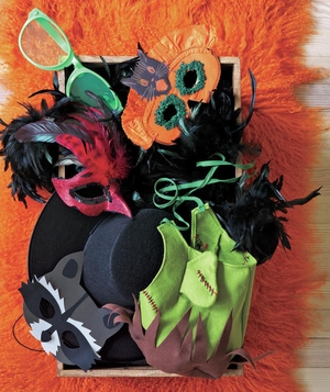 Box of Halloween masks and accessories