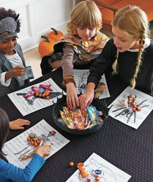 Kids at Halloween table with candy