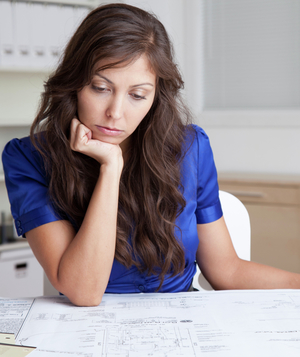 Woman reviewing blueprints