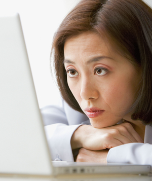 Woman staring at laptop