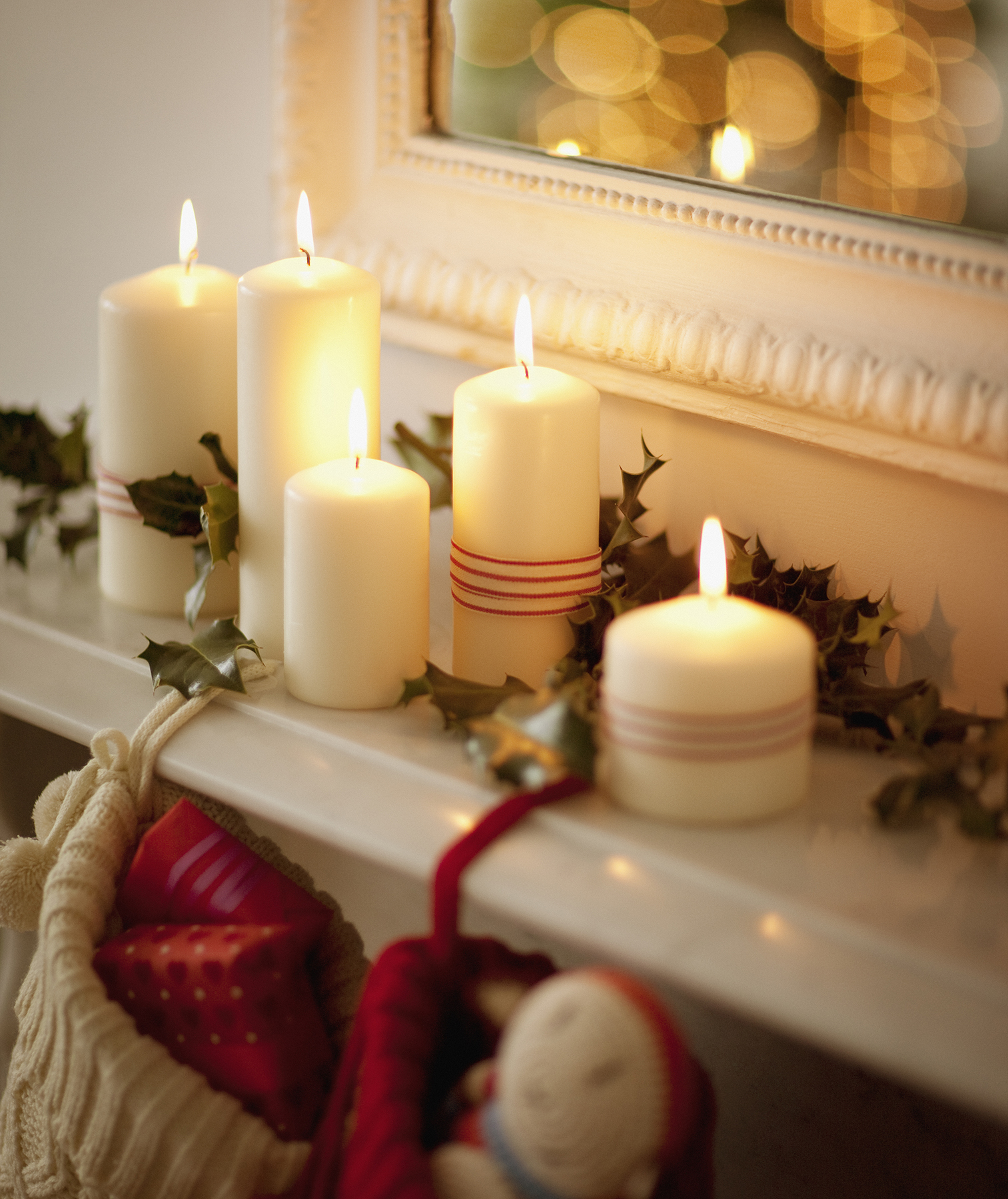 Candles on Christmas mantel