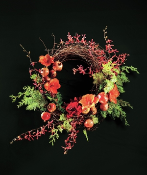 Fruit and flowers on a branch wreath