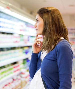 Woman looking at supermarket shelves