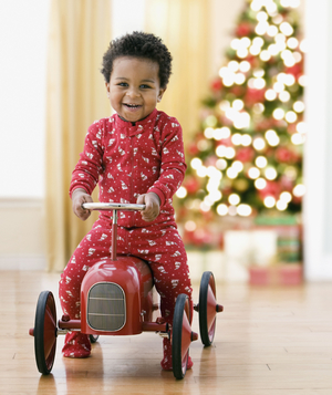 Toddler driving toy car at Christmas