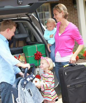 Family packing car for holiday vacation