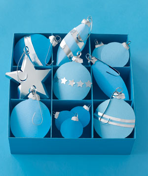 Paper construction of ornaments in box by Matthew Sporzynski