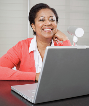 Woman at computer with webcam