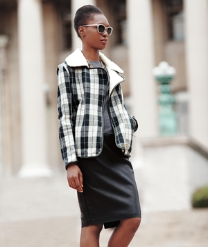 Model wearing plaid jacket and faux leather skirt