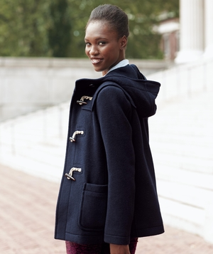 Model wearing Uniqlo wool coat with patterned jeans