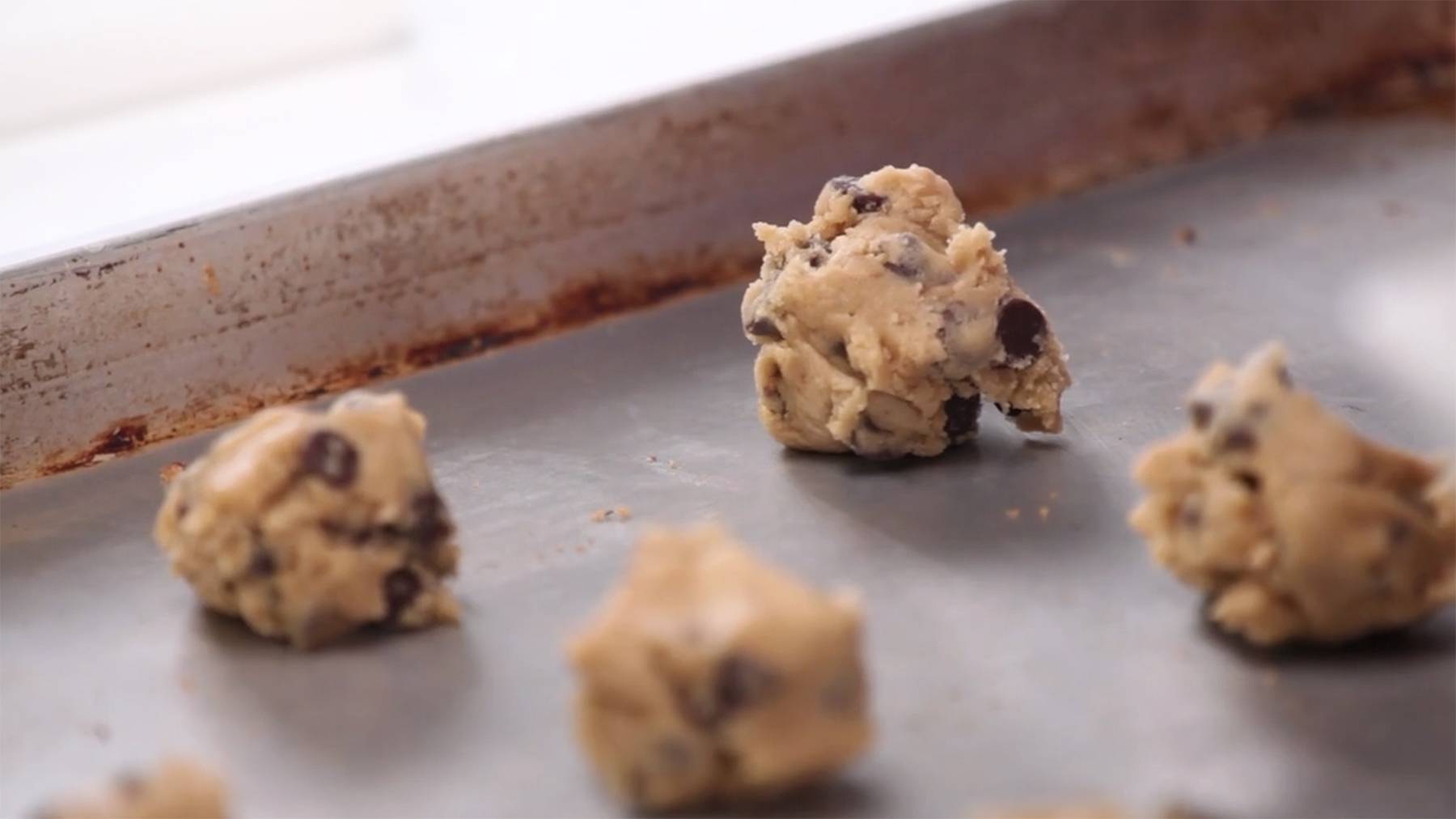 Cookie dough on cooled baking sheet