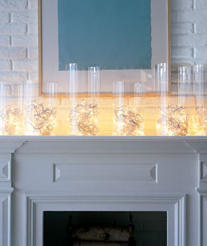 Holiday lights coiled in bottomless hurricane lamps