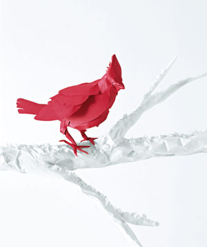 Paper construction of red robin on branch by Matthew Sporzynski