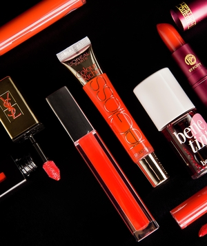 Variety of red lip stains, glosses, balms