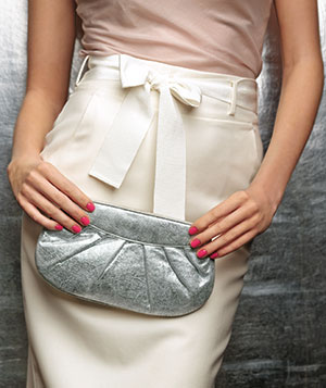 Pink nails and silver clutch