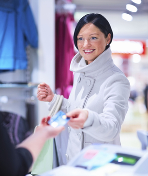 Woman paying at store with credit card