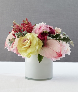 Floral centerpiece in white vase