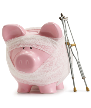 Piggy bank with bandages and crutches