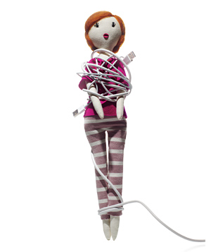 Doll tangled in phone charger cable