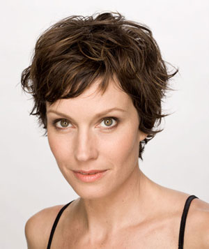 Brunette model with tousled pixie cut