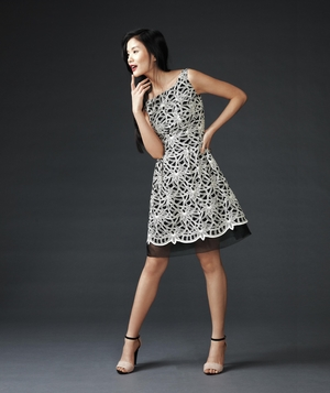 Model in black and white A-line dress