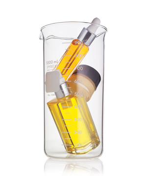 Beauty products in glass beaker