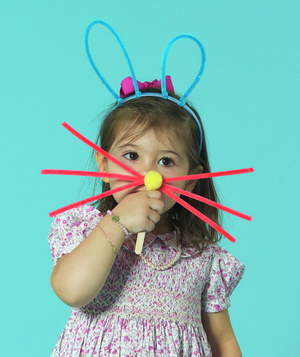 Girl with bunny ears and whiskers