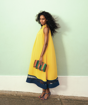 Model in yellow silk tent dress