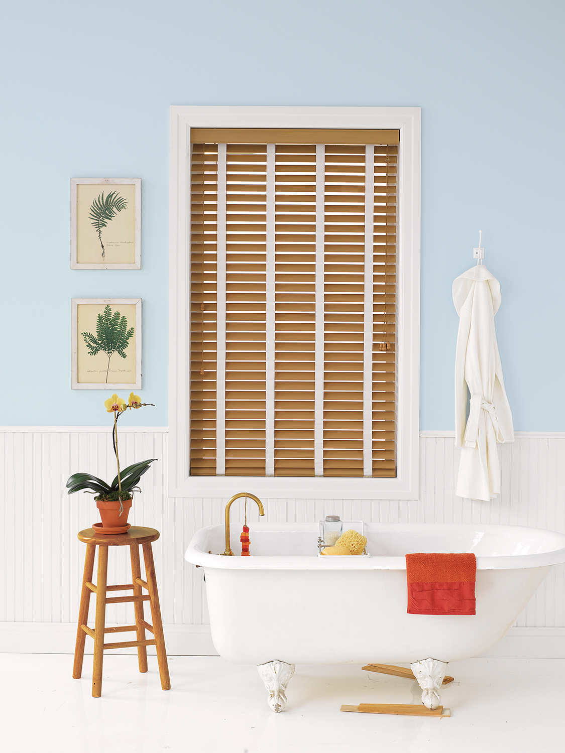 One attractive option for window treatments is faux-wooden blinds, which offer all the elegance of real wood and none of the worries of water damage or warping.