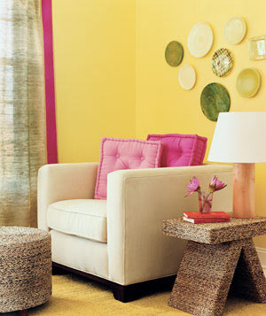 cheap living room decorating ideas. Plates in unexpected colors as wall decoration 20 Low Cost Decorating Ideas  Real Simple