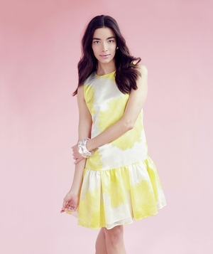 Model wearing yellow drop-waist dress