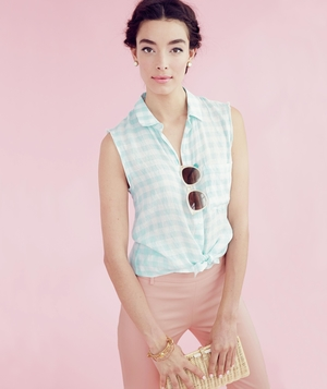 Model wearing gingham shirt and cotton-blend-pants
