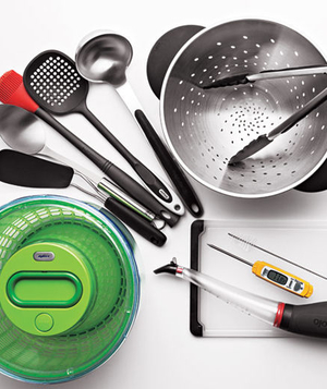 Spatulas, a salad spinner, a strainer, and a baster