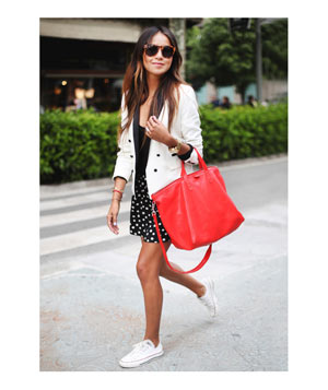 White jacket, red bag, flowy shorts