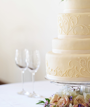 Wedding cake and wine glasses